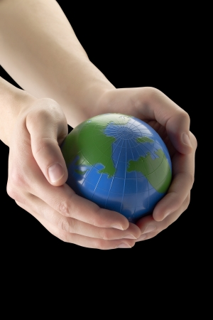 Environmental concept represented by a hand holding a globe