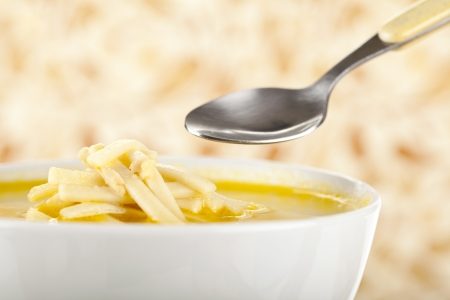 chicken noodle soup: Healthy Chicken Noodle Soup on bowl with spoon