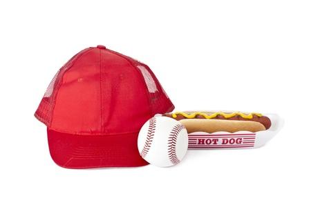 Hotdog sandwich beside a baseball cap and baseball Stock Photo - 17151744