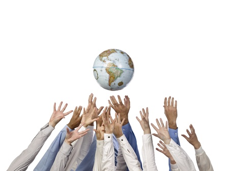 Group of human hands reaching a globe isolated in a white background