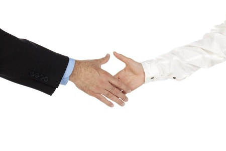 Isolated image of man and woman hand going to do a handshake against a white background Stock Photo - 17151092