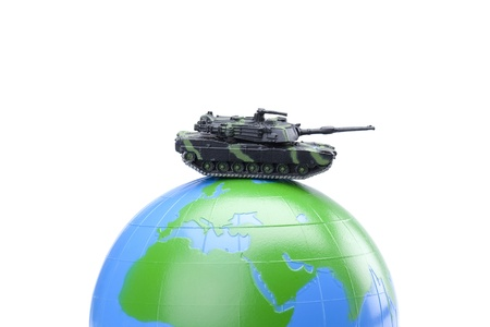 defending: Close-up image of a military fighter tank defending the globe against the white background