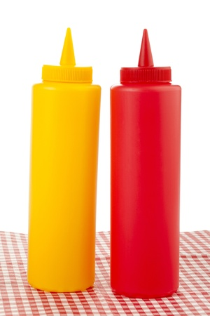 Mustard and ketchup in a squeeze bottles photo