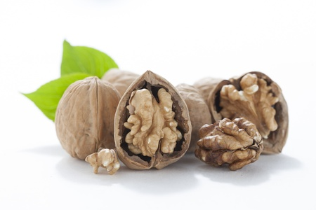 Close up image of open walnuts against white background Stock Photo - 17152416