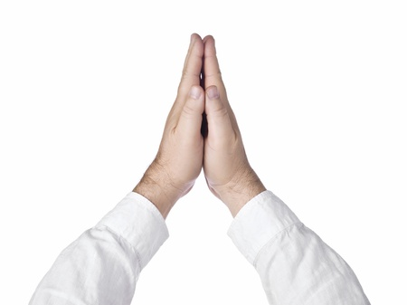 Male hands praying isolated  in a white background Stock Photo - 17151341