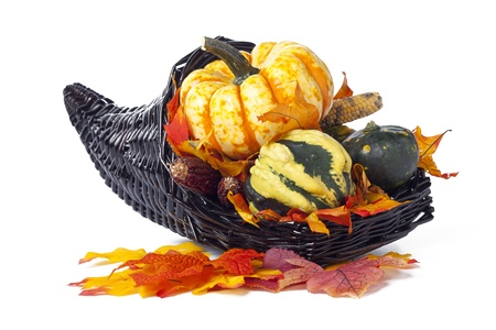 grasp: A cornucopia holding a selection of gourds and a pumpkin in his grasp against a white backdrop.