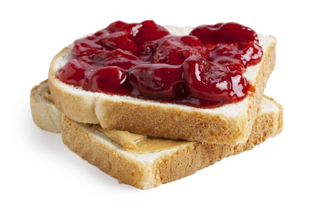 Close-up image of a slice of toasted bread with a spread of strawberry jam and peanut butter photo