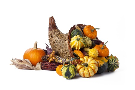 Vegetables in a wicker cornucopia on white. Stock Photo