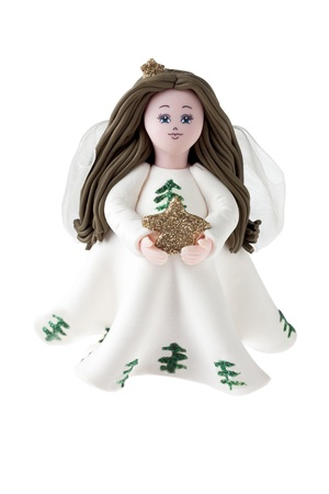 Beautiful angel figurine holding an ornament photo