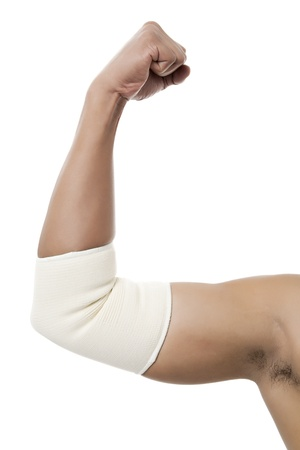 Close-up image of human arm with a bandage on his elbow isolated on a white background photo