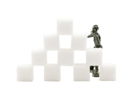 Soldier aiming his rifle on a pile of marshmallow photo