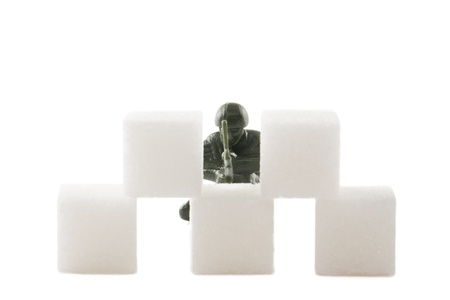 Soldier hiding on a pile of white marshmallow Stock Photo - 17151233