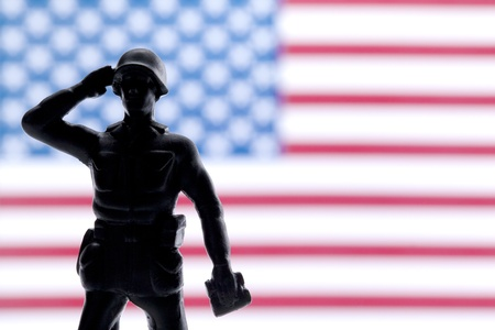 Soldier saluting and giving honor on his country Standard-Bild