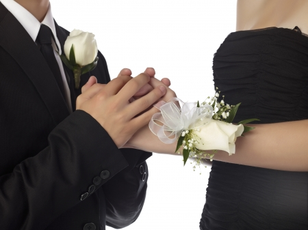 prom: Close up image of sweet couple hand against white background