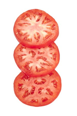 Three tomato slices over a white background photo