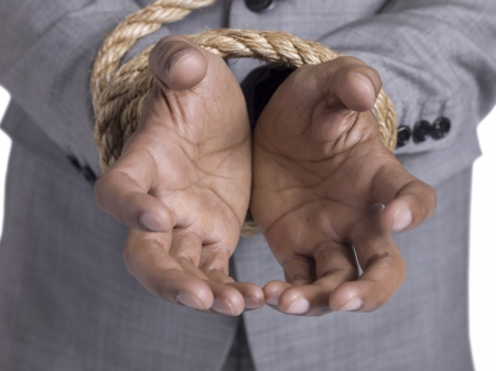 Close up shot of a man's hands tied with rope Stock Photo - 17183594