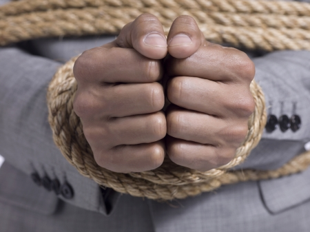knotting: Close-up image of a tied hand of a male Stock Photo