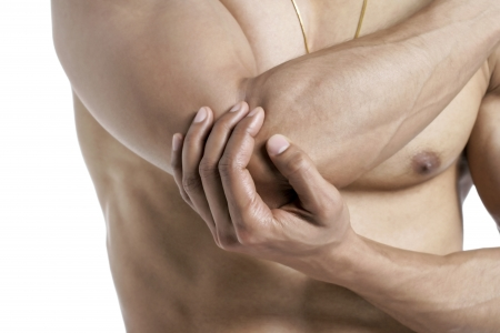 Cropped image of a topless man with elbow pain against the white surface Stock Photo - 17183365