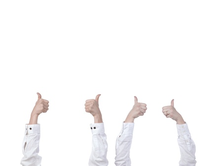Two pairs of hand with thumbs up isolated in a white background Stock Photo - 17182731