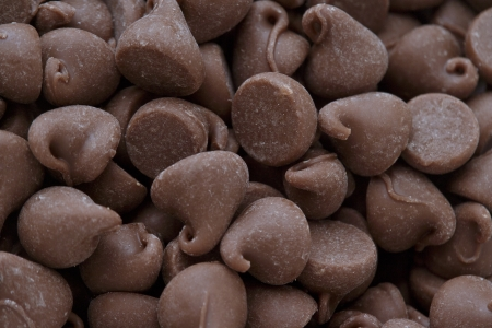 semisweet: Heap of chocolate chips in a macro image.