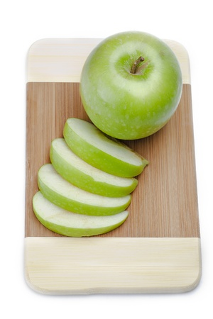 Apple on a cutting board, isolated on white. photo