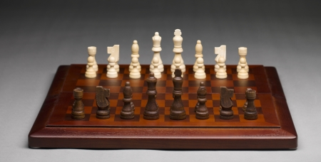 chellange: Chess pieces on a wooden chess board