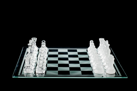 outwit: Chess pieces and chess board in a black background Stock Photo