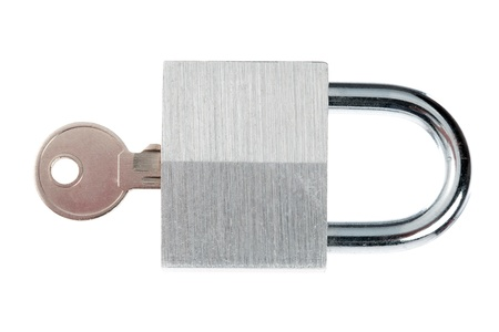 Close-up shot of shiny metal padlock and key over plain white background.