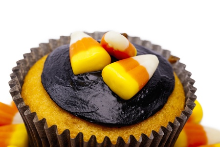 detailed shot: Detailed shot of a cupcake with candy corn and chocolate cream.