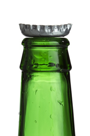 Close-up cropped shot of empty green bottle with cap. photo