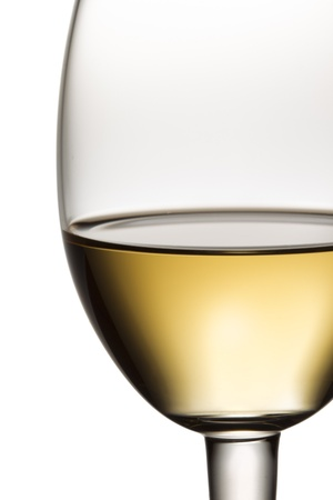 cropped shot: Close-up cropped shot of wine glass with white wine.