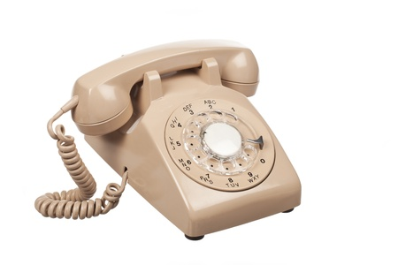 detailed image: Detailed image of a old rotary phone on white surface.