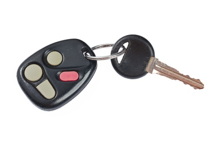 Detailed shot of plastic remote control car key with push button on plain white background.