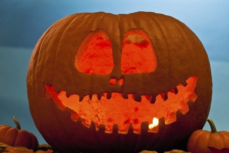 Close-up view of jack s lantern against blue background. photo