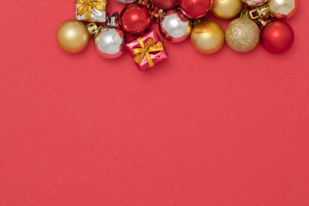 Image of colorful Christmas tree decorations against red background Stock Photo - 17208148