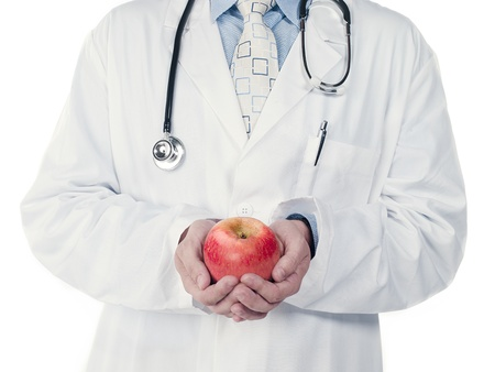 Cropped image of a doctor holding an apple over white background Stock Photo - 17189869