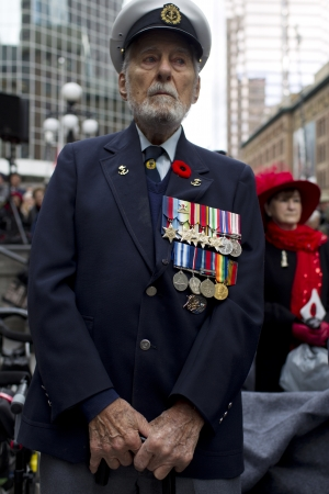 military uniform: Low angle view of senior citizen wearing a military uniform with medals.