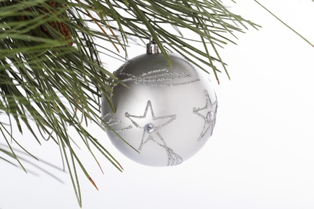 cele: Star shape on Christmas bauble hanging on Christmas tree against white background.