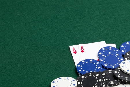 Pair of ace underneath a pile of chips