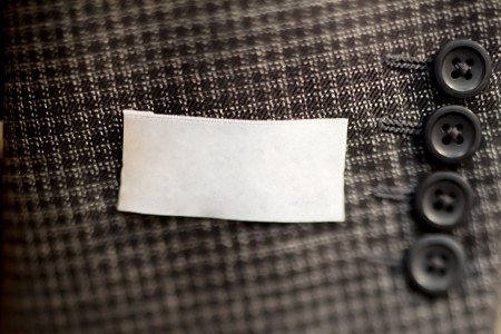 sleeve: Close-up of buttons on sleeve of mans suit.