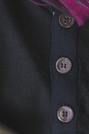 Button on the blue suit in a macro image Stock Photo - 17209971