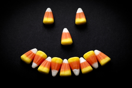 rubbery: Candy corn forming a happy face.