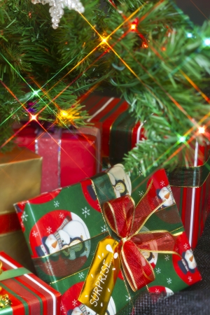 Close-up image of gifts surrounded on the Christmas tree Stock Photo - 17206222