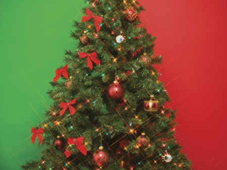 Cropped image of a Christmas tree covered with lights and decorations Stock Photo - 17208946