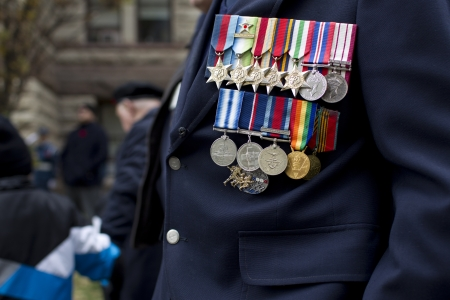 military uniform: Close-up shot of a medals on military uniform of a officer.