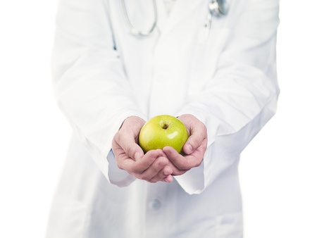 Cropped image of a doctor holding apple with cupped hands Stock Photo - 17186179