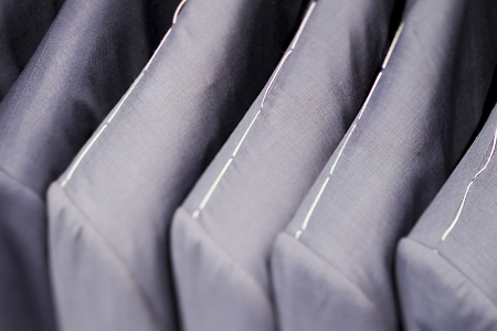 Full frame image of grey suits. photo