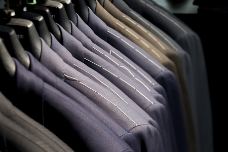 Close-up of suits on clothes rack. photo