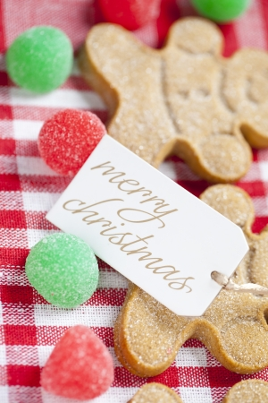 Extreme close-up shot of merry Christmas tag with gingerbread men. Reklamní fotografie