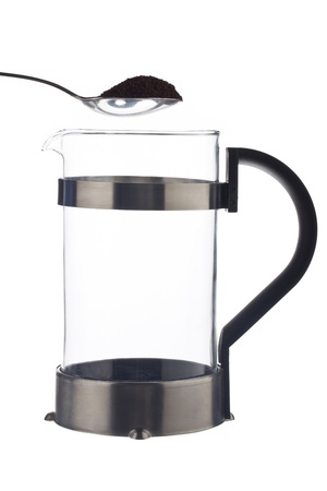 coffeepot: Coffeepot and spoon in a white background